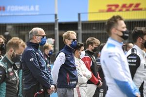 Christian Silk, Team Principal, NIO 333, Sylvain Filippi, Managing Director, Envision Virgin Racing, the other drivers, team members stand in memory of the late Adrian Campos