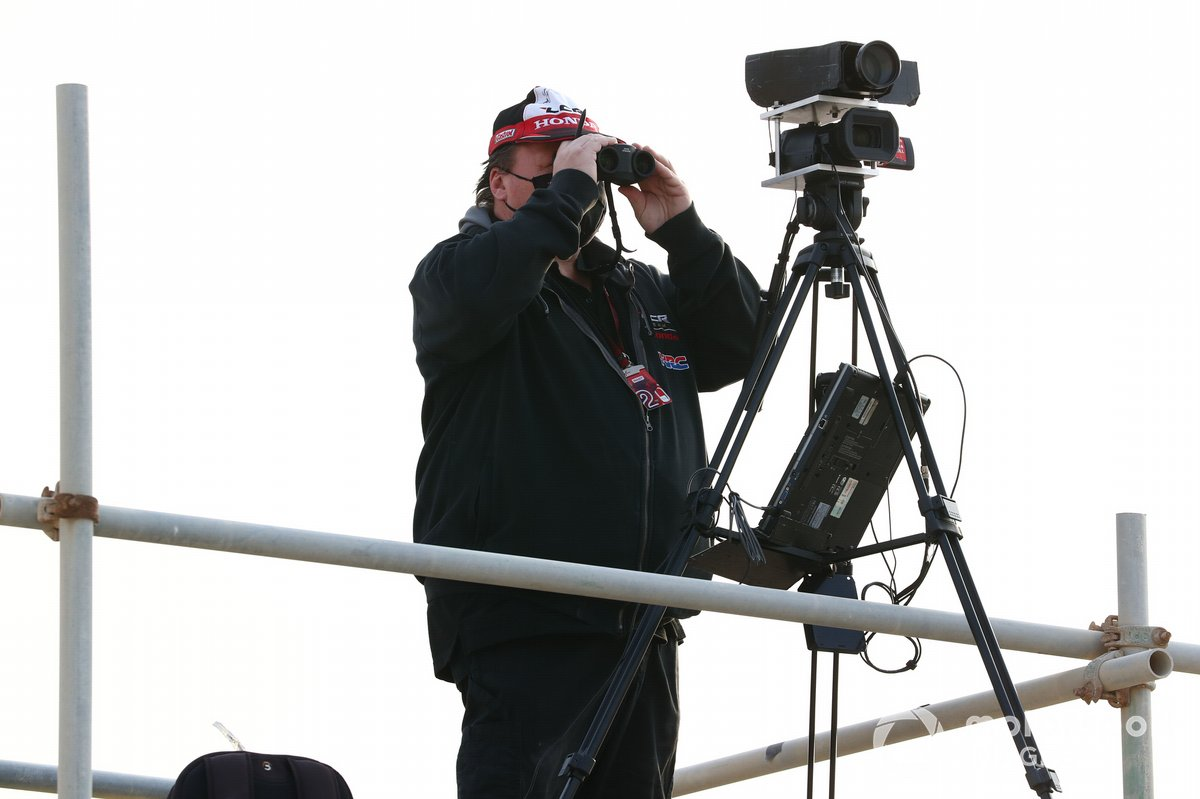 Team technicians observing with cameras