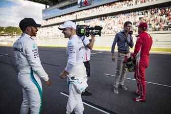 Lewis Hamilton, Mercedes AMG F1, congratulates his team mate Valtteri Bottas, Mercedes AMG F1