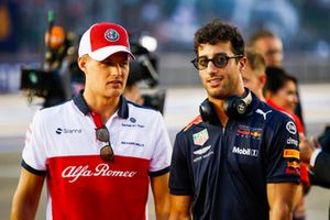 Marcus Ericsson, Sauber, and Daniel Ricciardo, Red Bull Racing, at the drivers parade