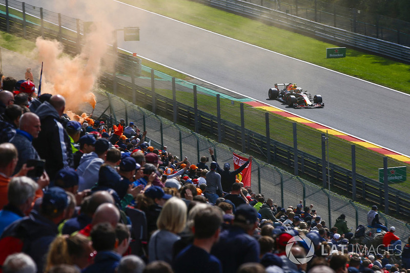 Max Verstappen, Red Bull Racing RB14, passes an orange flare and a bank of spectators