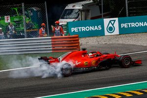 Sebastian Vettel, Ferrari SF71H lighting up his tyres after making contact with Lewis Hamilton, Mercedes AMG F1 W09