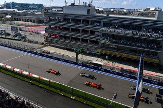 Charles Leclerc, Ferrari SF90, leads Lewis Hamilton, Mercedes AMG F1 W10, Sebastian Vettel, Ferrari SF90, Valtteri Bottas, Mercedes AMG W10, Carlos Sainz Jr., McLaren MCL34, Nico Hulkenberg, Renault F1 Team R.S. 19, and the rest of the field at the start