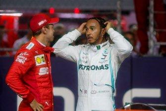 Sebastian Vettel, Ferrari, talks to Lewis Hamilton, Mercedes AMG F1