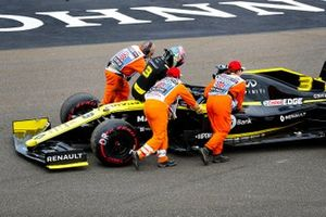 Marshals assist Daniel Ricciardo, Renault F1 Team R.S.19, after car failure