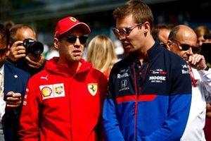 Sebastian Vettel, Ferrari and Daniil Kvyat, Toro Rosso