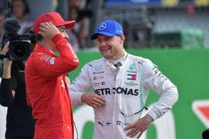 Ple man Charles Leclerc, Ferrari, and Valtteri Bottas, Mercedes AMG F1, on the grid after Qualifying