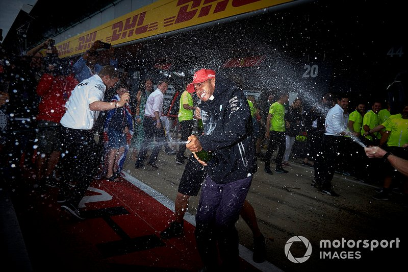 Mercedes team members blast Lewis Hamilton, Mercedes AMG F1, 1st position, with Champagne