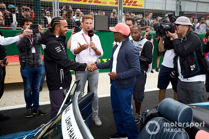 Lewis Hamilton, Mercedes AMG F1, shakes hands with his father Anthony Hamilton