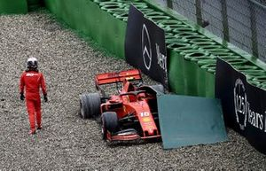 Charles Leclerc, Ferrari, walks away from his car after crashing out of the race