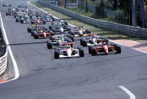 Ayrton Senna, McLaren MP4-6 Honda, leads Alain Prost, Ferrari 643 at the start of the race