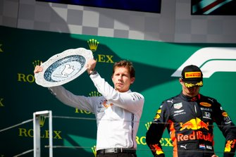 James Vowles, Motorsport Strategy Director, Mercedes AMG F1, receives the Constructors trophy for Mercedes alongside Max Verstappen, Red Bull Racing, 2nd position