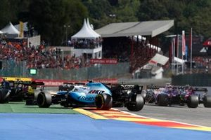 Daniel Ricciardo, Renault F1 Team R.S.19, and George Russell, Williams Racing FW42, run wide in avoidance at the start