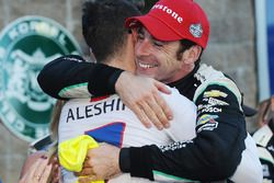 Race winner and 2016 champion Simon Pagenaud, Team Penske Chevrolet is congratulated by Mikhail Ales