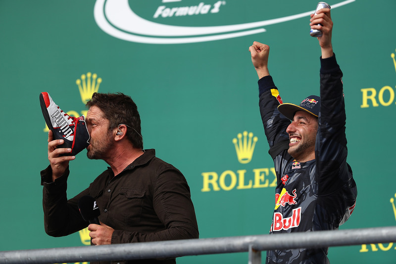 Actor Gerard Butler does a shoey on the podium with 3rd place Daniel Ricciardo, Red Bull Racing