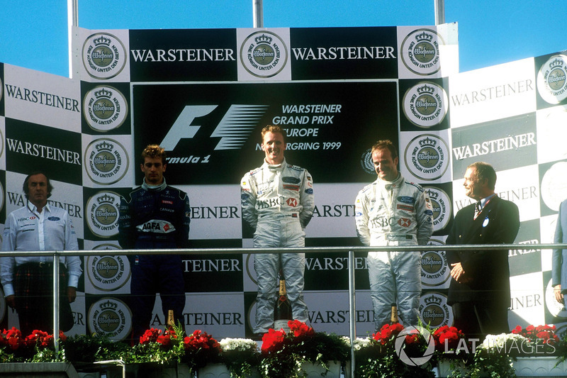 Podium: race winner Johnny Herbert, Stewart-Ford SF-3, second place Jarno Trulli, Prost Peugeot AP02