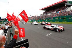 #8 Toyota Gazoo Racing Toyota TS050: Sébastien Buemi, Kazuki Nakajima, Fernando Alonso, #7 Toyota Gazoo Racing Toyota TS050: Mike Conway, Kamui Kobayashi, Jose Maria Lopez cross the finish line