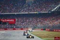 Carlos Sainz Jr., Renault Sport F1 Team R.S. 18, leads Charles Leclerc, Sauber C37