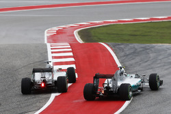 Lewis Hamilton, Mercedes F1 W06 Hybrid, and Nico Rosberg, Mercedes F1 W06 Hybrid, battle for the lead through the first corner