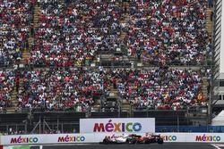 Lance Stroll, Williams FW40 and Sebastian Vettel, Ferrari SF70H