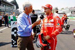 Damon Hill interviews pole position winner Sebastian Vettel, Ferrari