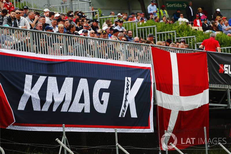 Fans display a banner in support of Kevin Magnussen