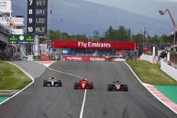 Kevin Magnussen, Haas F1 Team VF-18, Sebastian Vettel, Ferrari SF71H e Valtteri Bottas, Mercedes AMG F1 W09