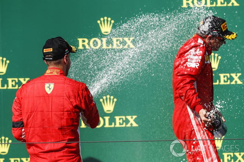 Sebastian Vettel, Ferrari, 2nd position, sprays Kimi Raikkonen, Ferrari, 3rd position, with Champagne