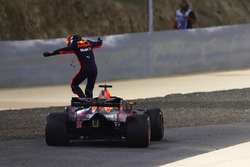 Daniel Ricciardo, Red Bull Racing RB14 Tag Heuer, jumps from his car after retiring from the race