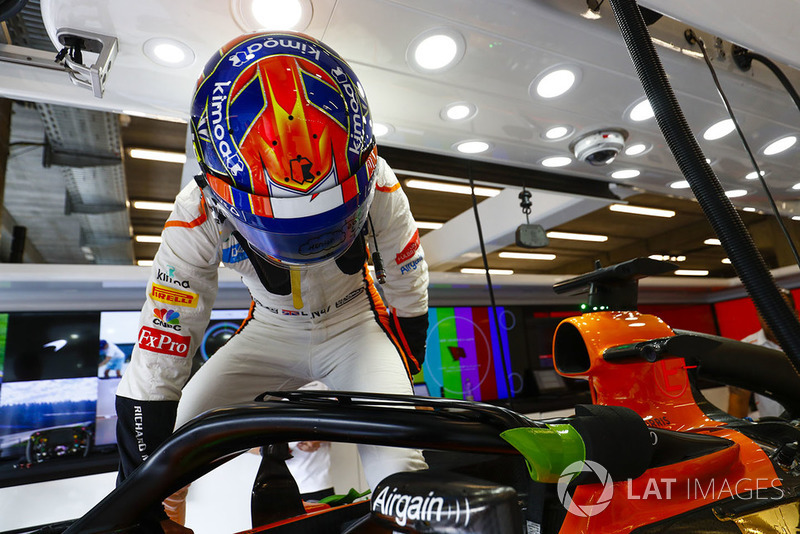 Lando Norris, McLaren, prepares to enter his cockpit