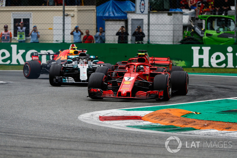 Kimi Raikkonen, Ferrari SF71H, leads Sebastian Vettel, Ferrari SF71H, Lewis Hamilton, Mercedes AMG F1 W09, and Max Verstappen, Red Bull Racing RB14, at the start of the race