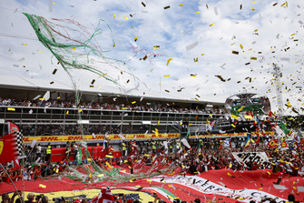 Lewis Hamilton, Mercedes AMG F1, first position, Kimi Raikkonen, Ferrari, second position, and Valtteri Bottas, Mercedes AMG F1, third position, celebrate on the podium as streamers and confetti fall on the gathered crowd