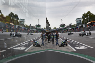 Lewis Hamilton, Mercedes AMG F1 W09, leads Valtteri Bottas, Mercedes AMG F1 W09, in the pit lane