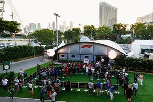 The media gather outside the F1 TV production unit for the daily drivers media session