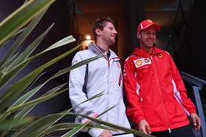 Romain Grosjean, Haas F1 Team, Sebastian Vettel, Ferrari