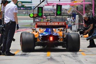 Lando Norris, McLaren MCL34, in the pits during practice
