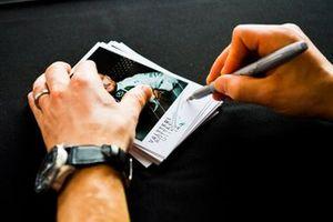 Valtteri Bottas, Mercedes AMG F1 signs a autograph for a fan