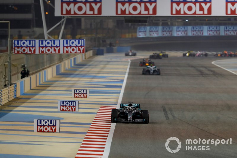 Lewis Hamilton, Mercedes AMG F1 W10, leads Valtteri Bottas, Mercedes AMG W10, and Max Verstappen, Red Bull Racing RB15