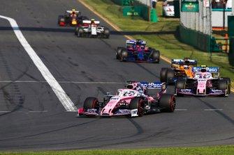 Sergio Perez, Racing Point RP19, leads Lance Stroll, Racing Point RP19, Carlos Sainz Jr., McLaren MCL34, and Daniil Kvyat, Toro Rosso STR14