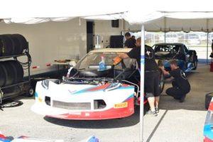 Crew members work on the #59 TA Chevrolet Corvette driven Simon Gregg of Derhaag Motorsports