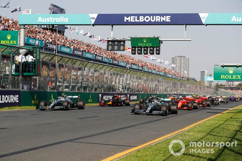 The lights go out and Lewis Hamilton, Mercedes AMG F1 W10, leads Valtteri Bottas, Mercedes AMG W10, Sebastian Vettel, Ferrari SF90, Max Verstappen, Red Bull Racing RB15, and the rest of the field away at the start