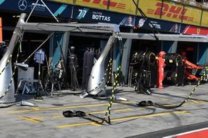 Wheel guns in the Mercedes pit area