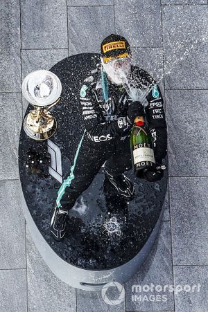 Valtteri Bottas, Mercedes-AMG F1, 1st position, celebrates with Champagne on the podium