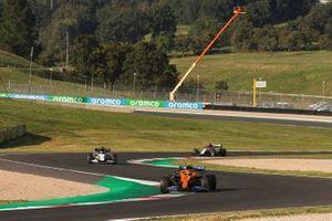 Lando Norris, McLaren MCL35, Daniil Kvyat, AlphaTauri AT01, and Kimi Raikkonen, Alfa Romeo Racing C39