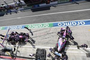 Sergio Perez, Racing Point RP20, and Lance Stroll, Racing Point RP20, in the pit lane