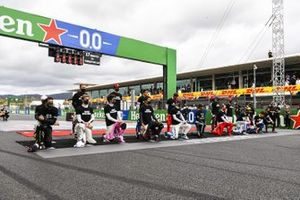 Drivers including Lewis Hamilton, Mercedes-AMG F1 taking a knee