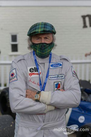 Sir Jackie Stewart wears a tartan face mask
