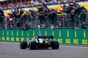 Sebastian Vettel, Aston Martin AMR21, 2nd position, passes his cheering team on the pit wall