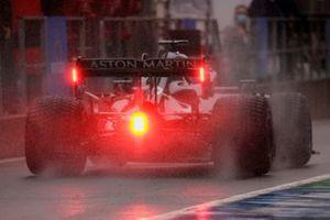 Lance Stroll, Aston Martin AMR21, in the pit lane