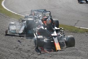 Max Verstappen, Red Bull Racing RB16B, and Lewis Hamilton, Mercedes W12, collide at the first chicane and retire from the race
